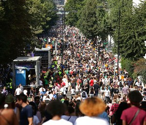 Crowds attend the Family Day at the Notting Hill Carnival in west London. (Yui Mok/PA via AP)
