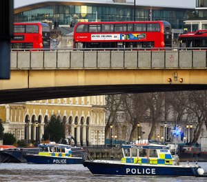 Boats from the Metropolitan Police Marine Policing Unit patrol near the scene after people were reported injured during a stabbing on London Bridge, police have said, on Friday, Nov. 29, 2019 in London, England. (Peter Summers/Getty Images/TNS)