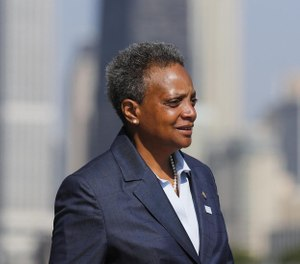 Mayor Lori Lightfoot speaks to the media regarding pausing the water meter program the before attending the Chicago Police Department graduation and promotions ceremony at Navy Pier in Chicago on July 9, 2019. (Jose M. Osorio/Chicago Tribune/TNS)