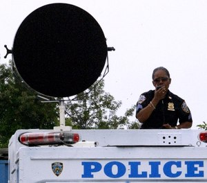 New York City Police Sgt. Janet Jordan gives orders using a Long Range Acoustic Device during a training drill in preparation for the Republican National Convention, Thursday, Aug, 19, 2004 in New York.