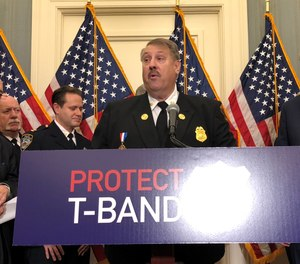 Members of U.S. Congress and public safety leaders, including IAFC President Gary Ludwig, held a press conference to call for the passage of legislation that would prevent the FCC from auctioning of the T-band spectrum, which is used for first responder communications throughout the country.