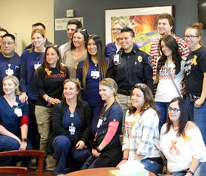 Staff of the emergency room at Spring Valley Hospital and first responders pose for a photo with survivors.