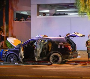 Instead of dispersing after the downtown Las Vegas protest was declared unlawful late Saturday, three men stuck around to set a Metro Police vehicle on fire.