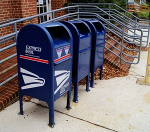 """A surveillance camera caught Jay Yang """"fishing"""" for mail at a post office on several occasions."""