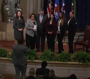 Suffolk County Detective William Maldonado's family was honored with a posthumous award for his work on the FBI task force that helped prosecute more than 40 MS-13 members. (Photo/TNS)