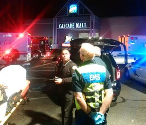 Authorities tweeted a photo from Cascade Mall where EMS were waiting to enter the scene of a shooting where three people were killed.