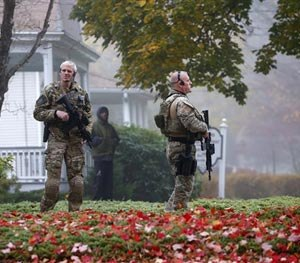Pennsylvania State Police SWAT officers stand by as Eric Frein arrives at the Pike County Courthouse for his arraignment in Milford, Pa., Friday Oct. 31, 2014.