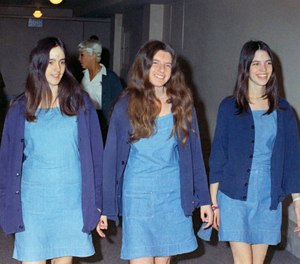 In this Aug. 20, 1970, file photo, Charles Manson followers, from left, Susan Atkins, Patricia Krenwinkel and Leslie Van Houten walk to court to appear for their roles in the 1969 cult killings of seven people in Los Angeles. (AP Photo/George Brich, File)