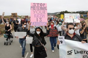 Sarzana Khan, center, and Gabriel Reyla, right, march with gay activists and supporters in San Francisco, Sunday, June 14, 2020, at a protest over the Memorial Day death of George Floyd. Image: AP Photo/Jeff Chiu