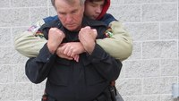 Defensive tactics training: Escaping from a bear hug from behind with your arms pinned
