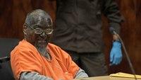 Man paints face black for life sentence hearing