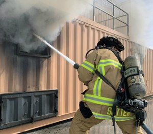 A firefighter engages in transitional attack training.