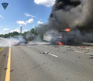 Firefighters and police responded to a tractor-trailer fire when another vehicle struck a police cruiser, causing the cruiser to hit a firefighter. A Massachusetts state trooper and the firefighter were transported to the hospital. (Photo/Massachusetts State Police)