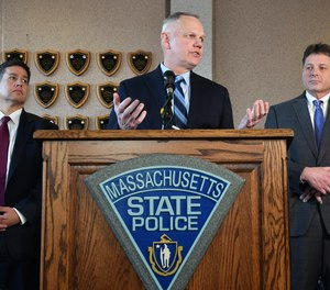 Col. Christopher Mason announced Friday that 22 troopers and officers face termination in connection with an overtime abuse scandal.