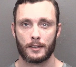Matthew D. Mattingly, 31, was charged with DWI, battery against a public safety official and other crimes after allegedly punching a firefighter in the face after falling off of his moped.