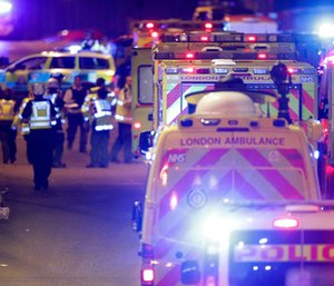 Emergency personnel on London Bridge after an incident in central London. (Dominic Lipinski/PA via AP)