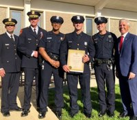 NY officers honored for rescuing 2 men from fires