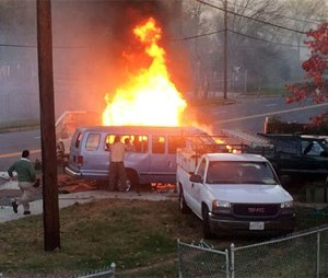 Flames rise from a vehicle following a fatal crash Sunday. (Steve Ramsey via AP)