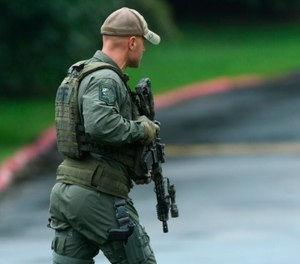 "Authorities respond to a shooting in Harford County, Md., on Thursday, Sept. 20, 2018. Authorities say multiple people have been shot in northeast Maryland in what the FBI is describing as an ""active shooter situation."" (Jerry Jackson /The Baltimore Sun via AP)"