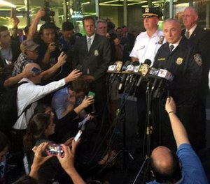 NYPD Commissioner William J. Bratton addresses the media after a homeless man with a meat cleaver hit an off-duty detective in the face Thursday afternoon at the end of a foot pursuit through midtown Manhattan.