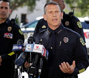 Orlando Police Chief John Mina answers questions at an afternoon news conference during a hostage standoff Monday, June 11, 2018, in Orlando, Fla.