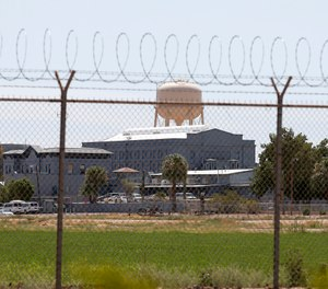 In this July 23, 2014 file photo, a fence surrounds the state prison in Florence, Ariz., where the execution of Joseph Rudolph Wood took place. (AP Photo/File)