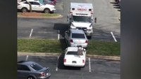 Video: Man arrested after ramming parked cars with ambulance