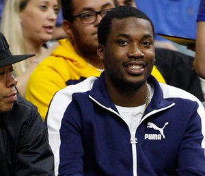 In this Wednesday, Feb. 3, 2016, photo, rapper Meek Mill looks on during the second half of an NBA basketball game between the Atlanta Hawks and the Philadelphia 76ers in Philadelphia. (AP Photo/Chris Szagola)