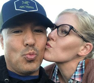 Officer Valentin Martinez and his longtime partner Megan Flynn share a kiss. (Photo/Megan Flynn via GoFundMe)