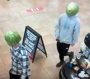 The Louisa (Va.) Police Department posted this image of two people suspected of robbing a Sheetz. (Photo/TNS)