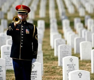 A lone U.S. Army bugler plays Taps at the conclusion of the First Annual Remembrance Ceremony in Dedication to Fallen Military Medical Personnel at Arlington National Cemetery, March 11, 2009.DoD photo by Mass Communication Specialist 1st Class Chad J. McNeeley