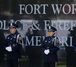 The Fort Worth Police Honor Guard stands at the memorial wall at the Fort Worth Police Department annual Peace Officers Memorial Service in Trinity Park, in this May 4, 2016 file photo.