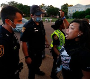Theryn Bond confronts Memphis police officers during protests on Union Avenue Wednesday night, May 27, 2020, in Midtown Memphis.
