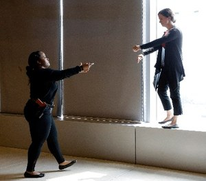 In this Sept. 2, 2015 file photo, Sgt. Cecilia Luckie, left, talks actress Erin Shields, off a ledge during a Crisis Intervention Training class at the New York Police Department Police Academy, in New York. (AP Photo/Mary Altaffer, File)