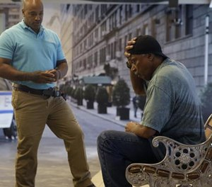 In this Wednesday, Sept. 2, 2015 photo, Officer Lamont Edwards talks to actor Nathan Purdee during a Crisis Intervention Training class at the New York Police Department Police Academy, in New York.