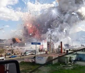 This image made from video recorded from a passing car shows an explosion ripping through the San Pablito fireworks' market in Tultepec, Mexico, Tuesday, Dec. 20, 2016. (Jose Luis Tolentino via AP)