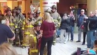 Mich. firefighter surprises girlfriend at work, proposes