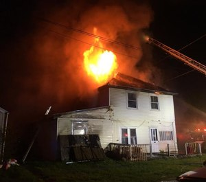 Three firefighters sustained minor injuries in a suspected arson blaze at a vacant house on Sunday.