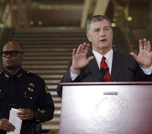 Dallas mayor Mike Rawlings, left , and Dallas police chief David Brown, right, during a news conference, Friday, July 8, 2016, in Dallas.