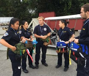 A group of millennial EMTs, who are current and former students of the University of California, Berkeley, and members of the Berkeley Medical Reserve Corps prepare for an Urban Shield MCI triage exercise. (Photo/Greg Friese)