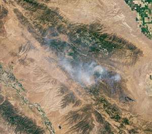 Officials said the Mineral Fire in Fresno County, Calif. was nearly contained Thursday after burning nearly 30,000 acres. (Photo/Lauren Dauphin, NASA Earth Observatory)