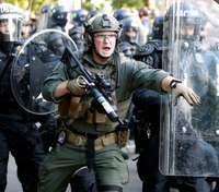 Videos: Protests continue as Trump warns of military action