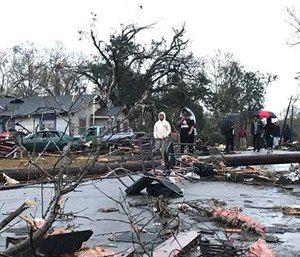 Trees and debris cover the ground after a tornado tornado ripped through the Hattiesburg, Miss., area early Saturday, Jan. 21, 2017. (Ryan Moore/WDAM-TV via AP)
