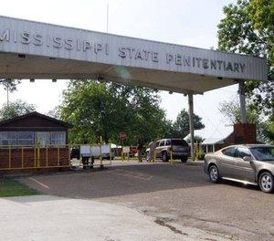 In this May 19, 2010, file photograph, traffic moves past the front of the Mississippi State Penitentiary in Parchman, Miss. (AP Photo/Rogelio V. Solis)