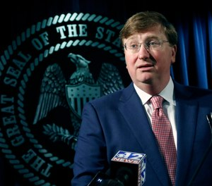 Republican Gov. Tate Reeves speaks with reporters about the state prison system, Thursday, Feb. 6. (Photo/AP)