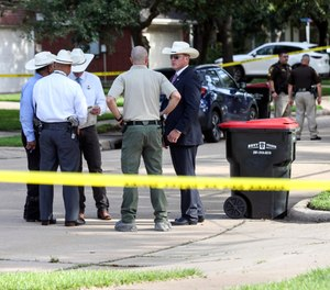 Authorities investigate the scene where a Fort Bend County Deputy Sheriff fatally shot a Fort Bend County Precinct 4 Deputy Constable after mistaking him for an intruder as they cleared a house, Friday, May 29, 2020, in Missouri City, Texas. (Photo/AP)