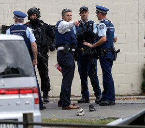 Police stand outside a mosque in central Christchurch, New Zealand, Friday, March 15, 2019. Multiple people were killed in mass shootings at two mosques full of people attending Friday prayers, as New Zealand police warned people to stay indoors as they tried to determine if more than one gunman was involved.