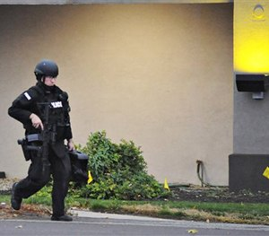 A police officer walks in front of Knights Inn after reports of a shooting in Bensalem Township near Trevose, Pa., Saturday, Nov. 7, 2015. (AP Image)
