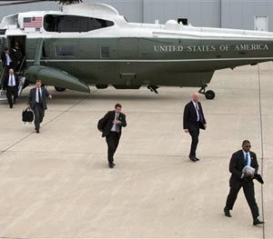 Secret Service agents arrive at Gary/Chicago International Airport ahead of the arrival of President Barack Obama, on Thursday, Oct. 2, 2014, in Gary, Ind. (AP Image)