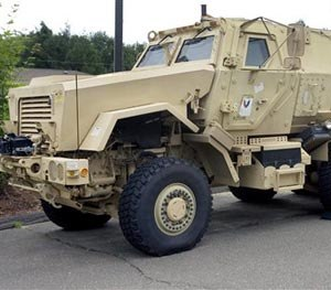 In this July 16, 2014 file photo, a Mine-Resistant Ambush Protected vehicle sits in front of police headquarters in Watertown, Conn. The L.A. Unified's School District police department received a MRAP vehicle like this one through a federal program.